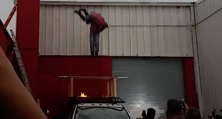 Wrestlers Jump Off Roof Through Fiery Table Into Bed Of