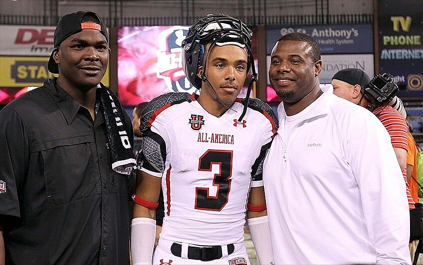 843992499c January 5, 2012; St. Petersburg, FL, USA; White team wide receiver Trey  Griffey (3) poses with his father Ken Griffey Jr. and former NFL player  Keyshawn ...