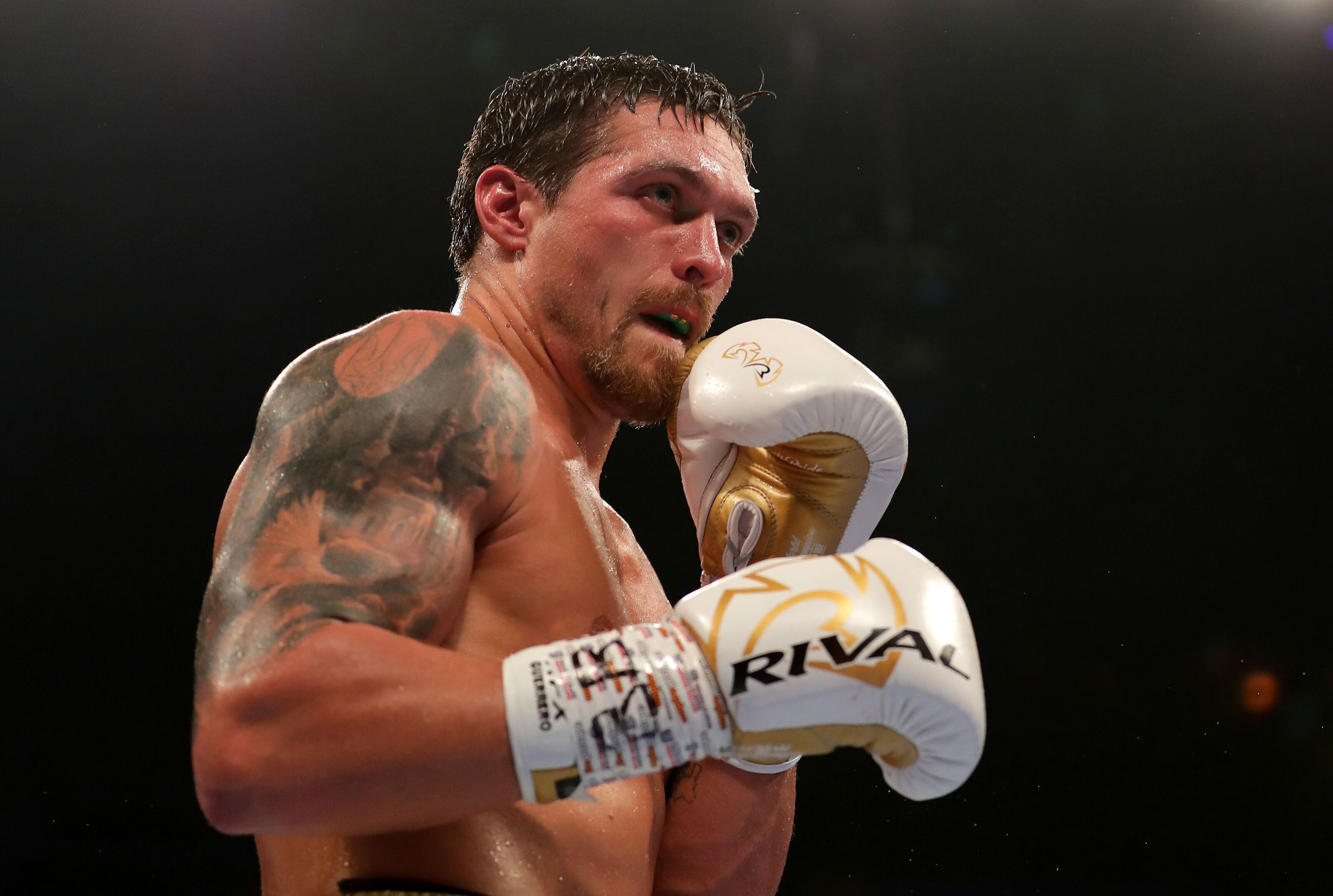 Oleksandr Usyk splashes into heavyweight division with a TKO win