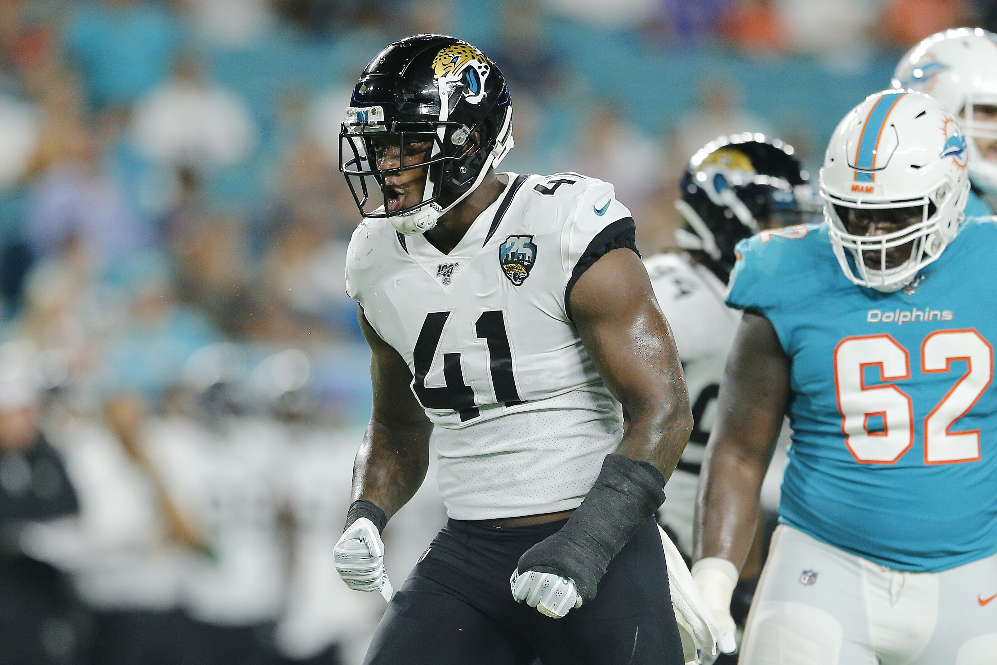 Jaguars defensive end Josh Allen squishes the Miami Dolphins