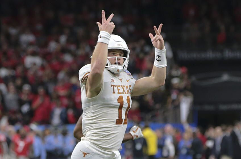 b824cd52 NEW ORLEANS, LA – JANUARY 01: Texas Longhorns quarterback Sam Ehlinger (11)  hypes the crowd after scoring in the first half during the Allstate Sugar  Bowl ...