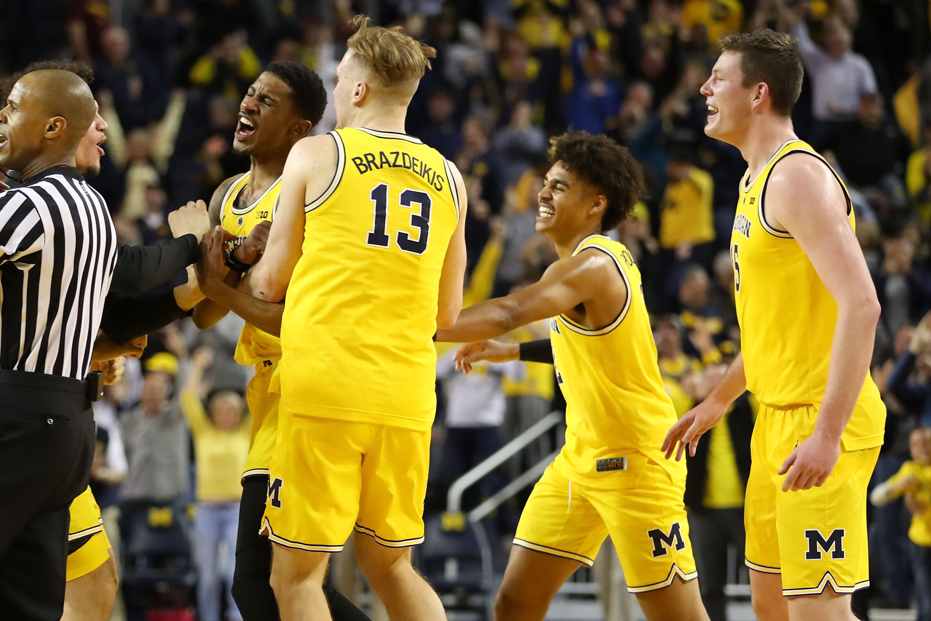 8dc34928a5a9ff Michigan Basketball  What would cause Iggy or Jordan Poole to return