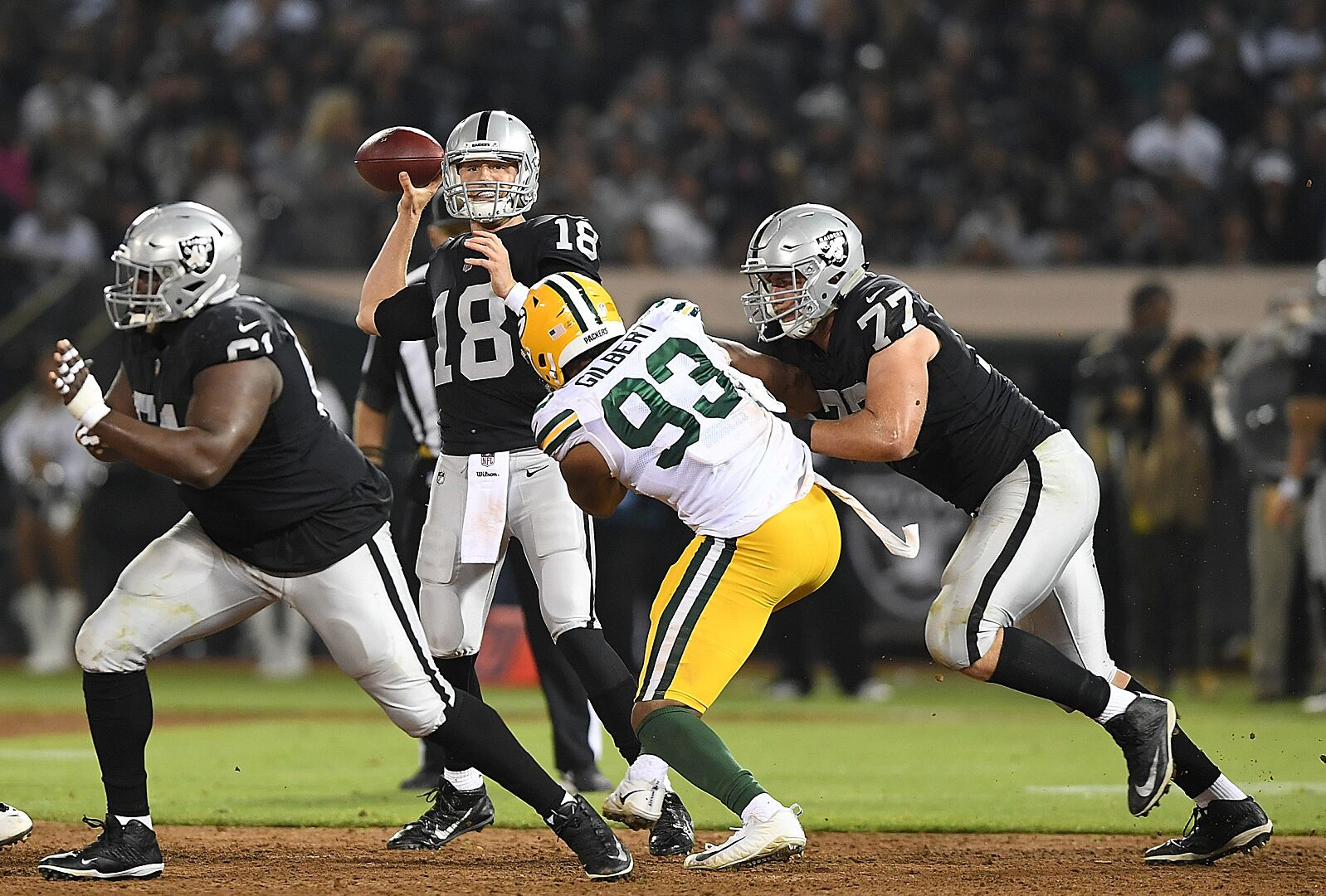 7872b675394 OAKLAND, CA – AUGUST 24: Connor Cook #18 of the Oakland Raiders looks to  pass against the Green Bay Packers during the second quarter of an NFL  preseason ...