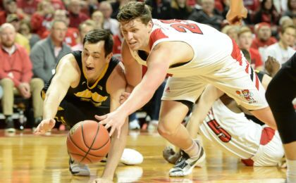 90015a8e122 LINCOLN, NE %26#8211; MARCH 10: Tanner Borchardt #20 of the Nebraska  Cornhuskers reaches for a loose ball with Ryan Kriener #15 of the Iowa  Hawkeyes at ...