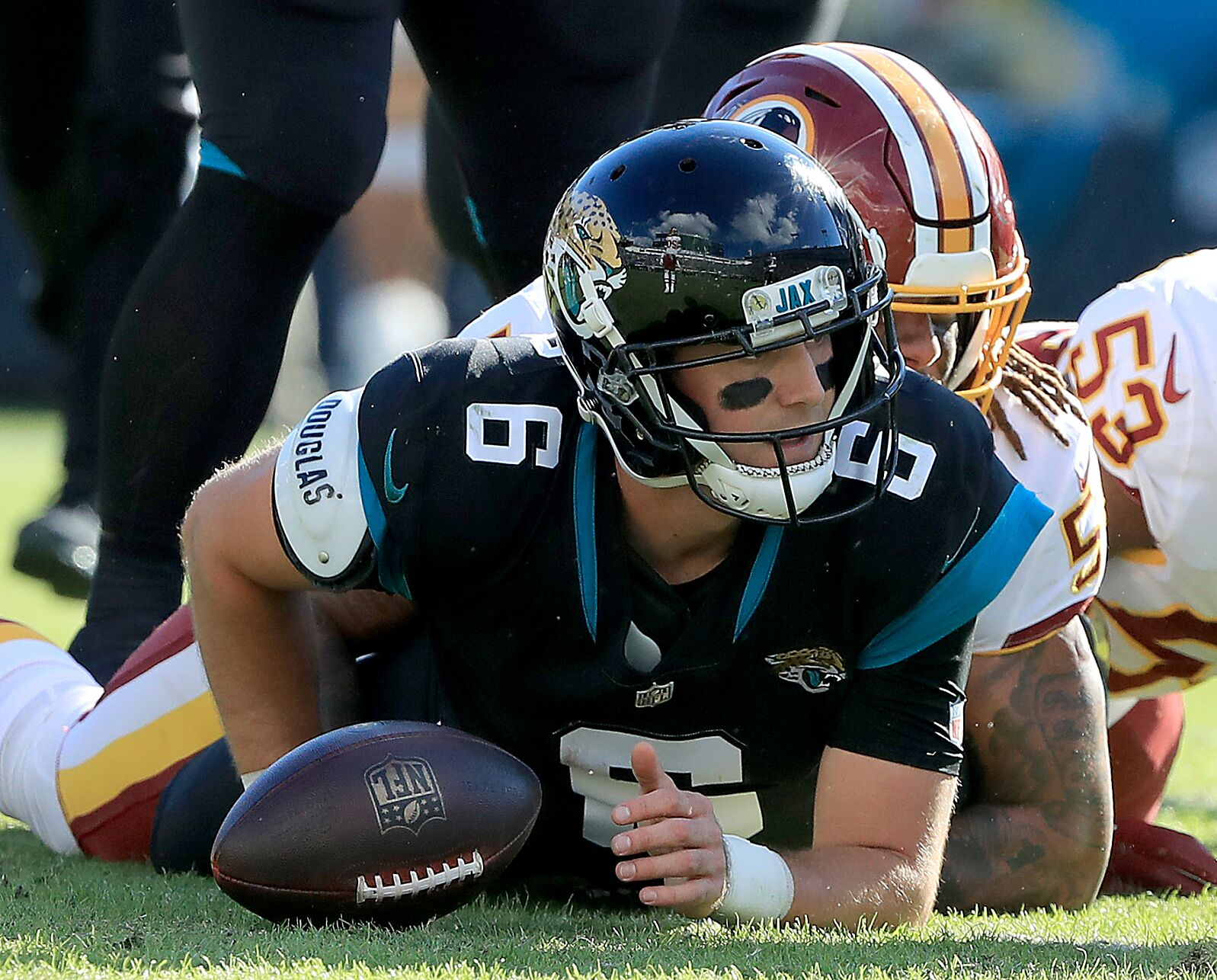 41d788fd746 JACKSONVILLE, FLORIDA – DECEMBER 16: Cody Kessler #6 of the Jacksonville  Jaguars is sacked by Jonathan Allen #93 of the Washington Redskins during  the game ...