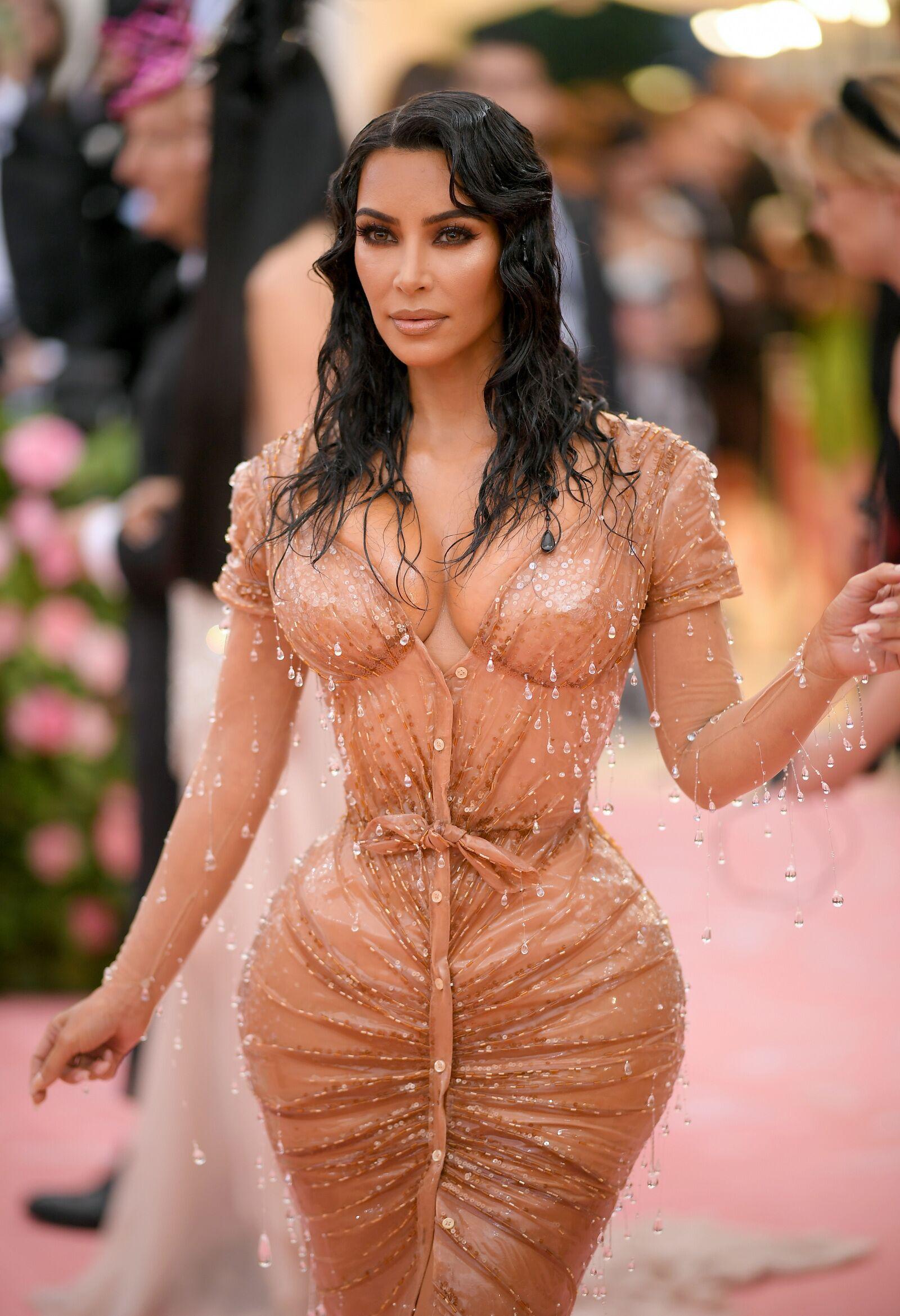 Kim Kardashian poses nearly nude for new glam shades