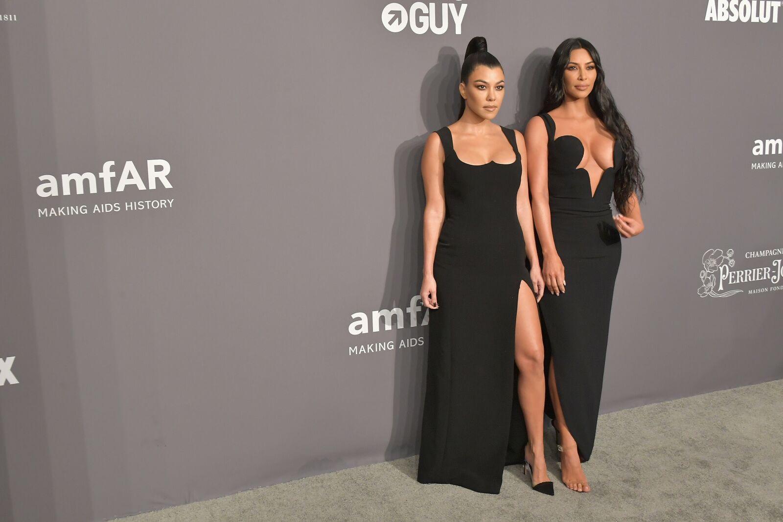 04dfeb4b Kim Kardashian poses in brightly colored dress, shows off body