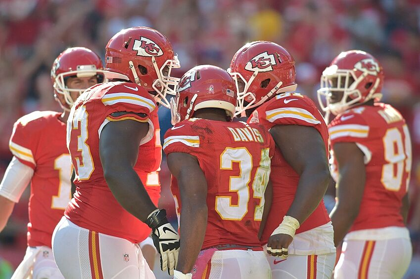 Oct 26, 2014; Kansas City, MO, USA; Kansas City Chiefs running back Knile Davis (34) is congratulated by teammates after scoring a touchdown during the second half against the St. Louis Rams at Arrowhead Stadium. The Chiefs won 34-7. Mandatory Credit: Denny Medley-USA TODAY Sports