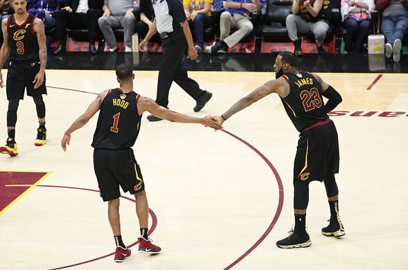 ab37de51 CLEVELAND,OH – Rodney Hood #1 of the Cleveland Cavaliers and LeBron James  #23 of the Cleveland Cavaliers high five in Game Four of the 2018 NBA Finals  on ...