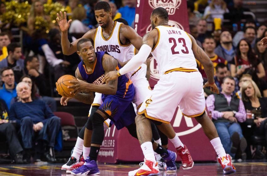 Cleveland Oh March  Eric Bledsoe  Of The Phoenix Suns Looks For A Pass While Being Double Teamed By Tristan Thompson  And Lebron James  Of The