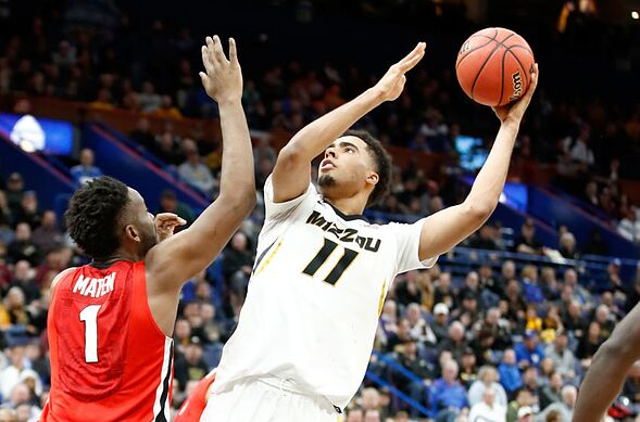 ... MO – MARCH 08  Jontay Porter  11 of the Missouri Tigers shoots the ball  against the Georgia Bulldogs during the second round of the 2018 SEC  Basketball ... 01796ddd9d6