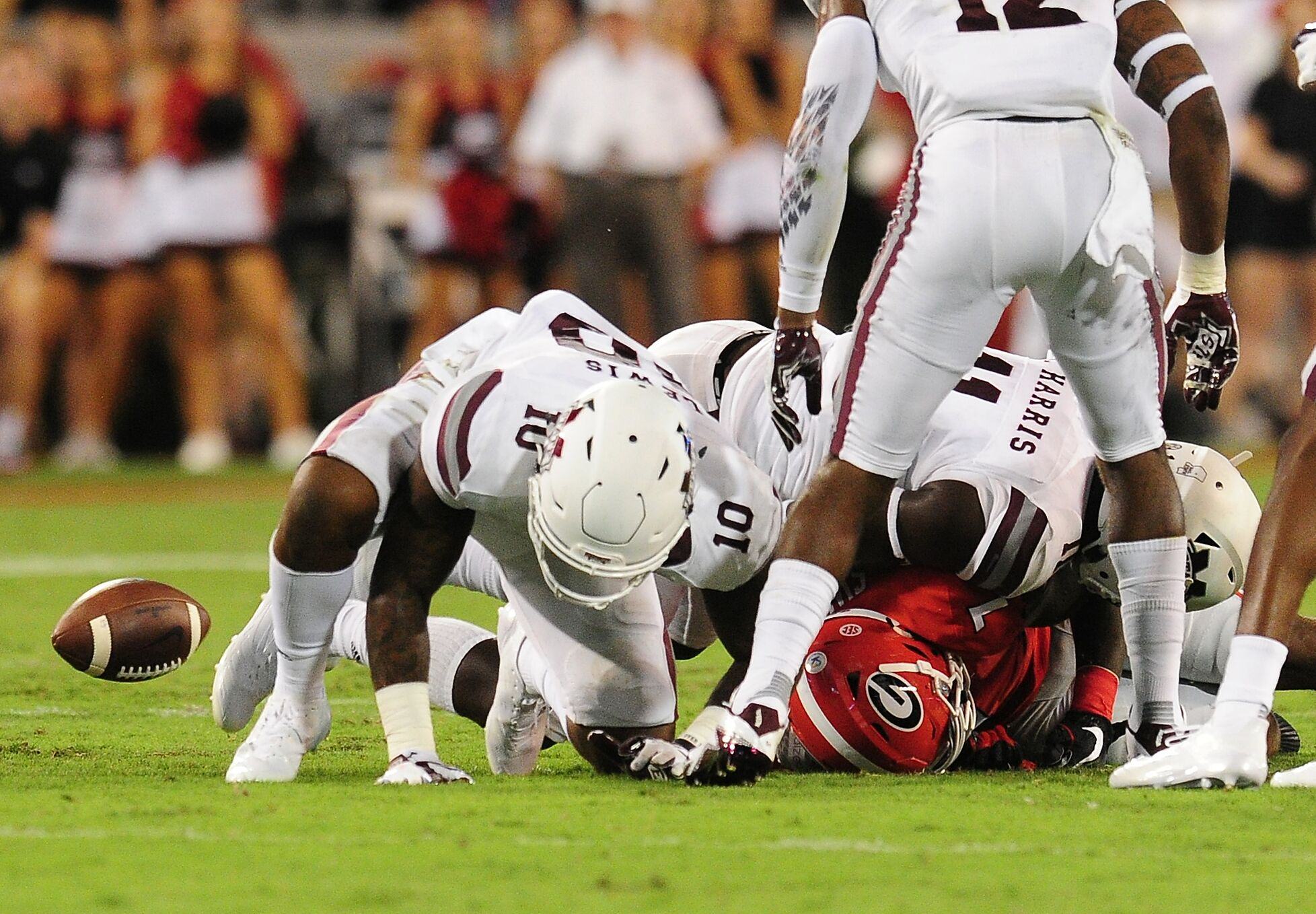 Athens Ga September 23 D Andre Swift 7 Of The Georgia Bulldogs Fumbles After Being Tackled By Leo Lewis 10 Anddez Harris 11 Mississippi State