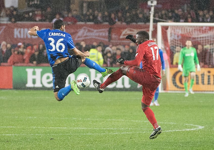 Nov 30, 2016; Toronto, Ontario, CAN; Toronto FC forward Jozy Altidore (17) battles for a ball with Montreal Impact defender Victor Cabrera (36) during the second half in the second leg of the MLS Eastern Conference Championship at BMO Field. Toronto FC won 5-2. Mandatory Credit: Nick Turchiaro-USA TODAY Sports