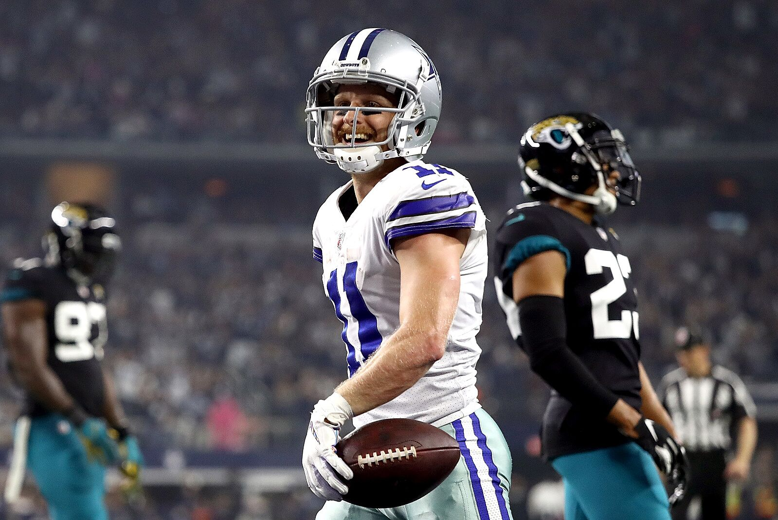 5f6948bd7 ARLINGTON, TX – OCTOBER 14: Cole Beasley #11 of the Dallas Cowboys smiles  after scoring a touchdown in the second quarter against the Jacksonville  Jaguars ...