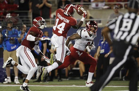 detailed look ec7bb 7d6ee ORLANDO, FL – SEPTEMBER 01  Deionte Thompson  14 of the Alabama Crimson  Tide intercepts a pass in the end zone intended for Jaylen Smith  9 of the  ...