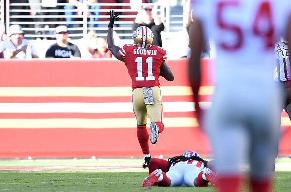 SANTA CLARA CA NOVEMBER 12 Marquise Goodwin 11 Of The San Francisco 49ers Breaks A Tackle From Janoris Jenkins 20 New York Giants On His Way To