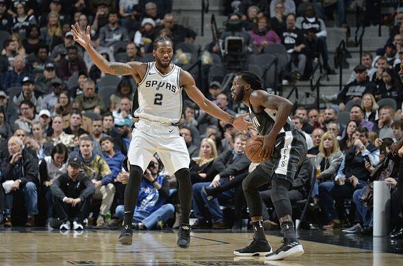 41aa25db8f11 Carroll  9 of the Brooklyn Nets handles the ball against Kawhi Leonard  2 of  the San Antonio Spurs on December 26