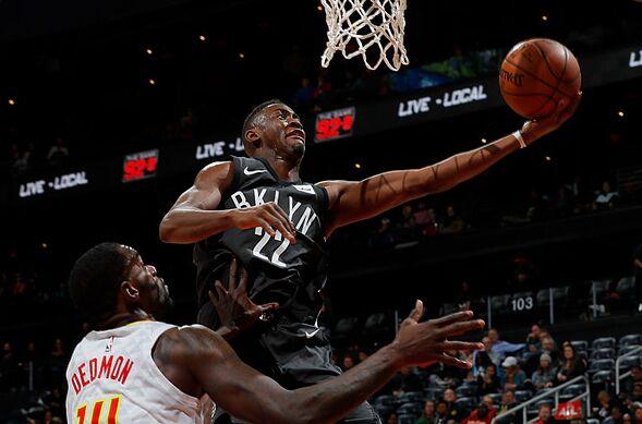 Atlanta Ga January 12 Caris Levert 22 Of The Brooklyn Nets Drives Against Dewayne Dedmon 14 Hawks At Philips Arena On