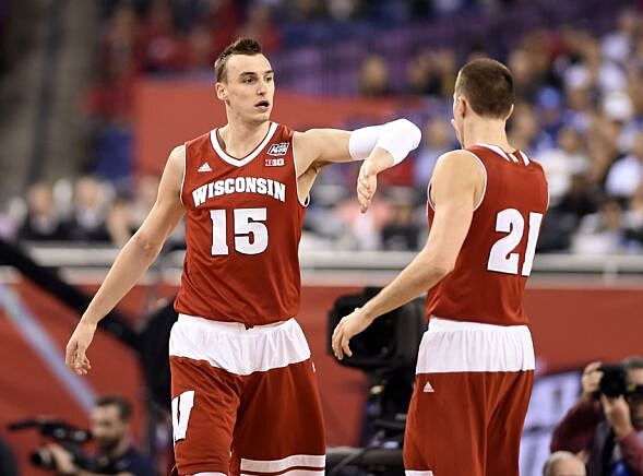 7cfea3567fa Apr 4, 2015; Indianapolis, IN, USA; Wisconsin Badgers guard Josh Gasser  (21) celebrates with forward Sam Dekker (15) after a basket against the  Kentucky ...
