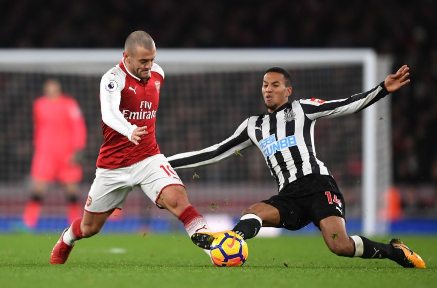 London England December  Jack Wilshere Of Arsenal Escapes The Challenge Of Isaac Hayden Of Newcastle United During The Premier League Match Between