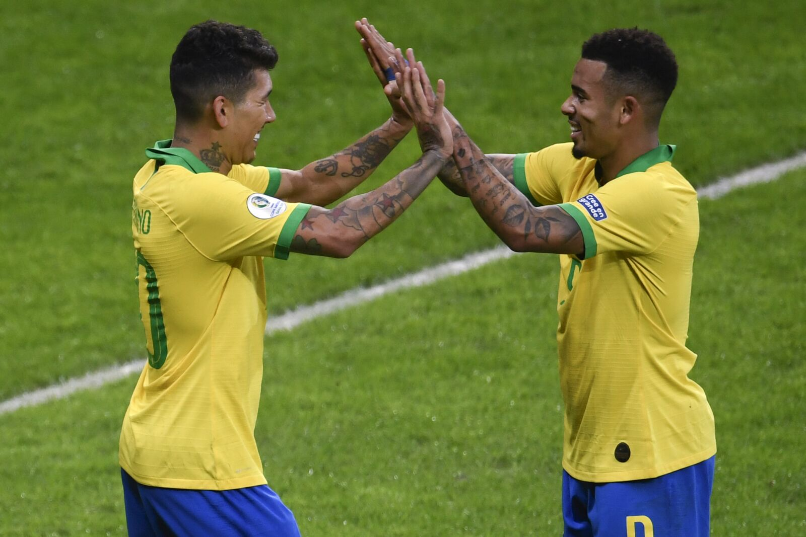 Roberto Firmino and Gabriel Jesus proving they can play together