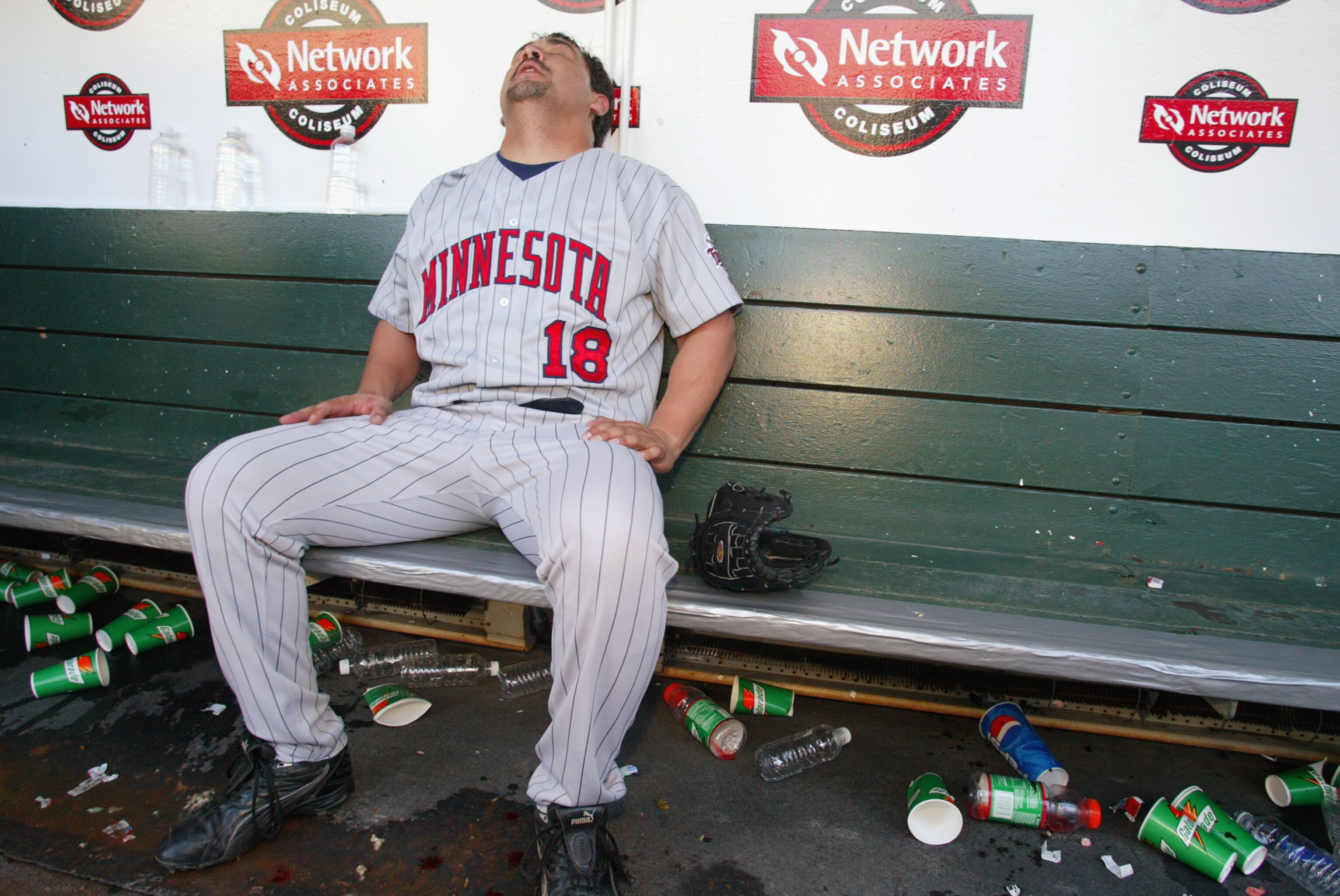 72499984-eddie-guardado-sits-in-the-dugout.jpg