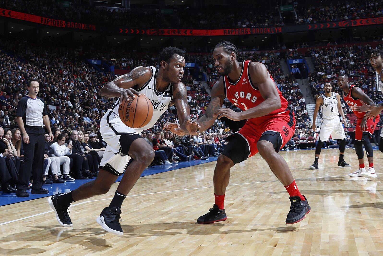 Toronto Raptors – Kawhi Leonard and Brooklyn Nets Treveon Graham (Photo by  Mark Blinch NBAE via Getty Images) 40bca8904