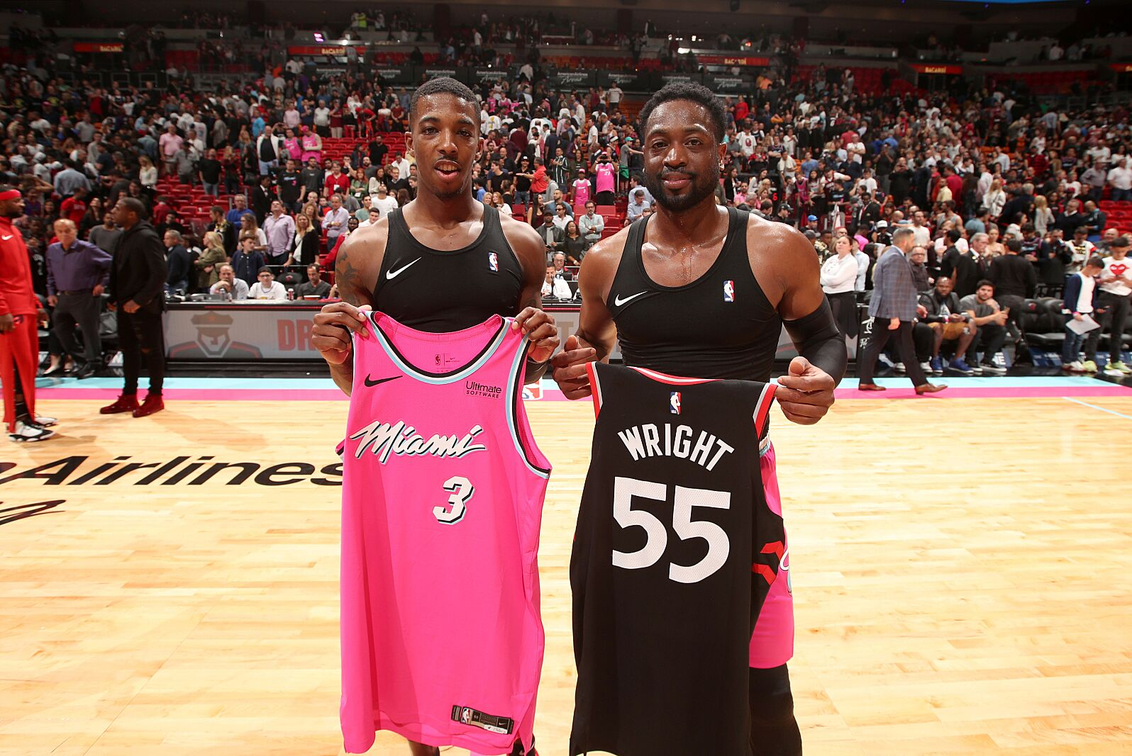 9786ac3b423 MIAMI, FL – DECEMBER 26: Delon Wright #55 of the Toronto Raptors and Dwyane  Wade #3 of the Miami Heat exchange jerseys after the game on December 26,  ...