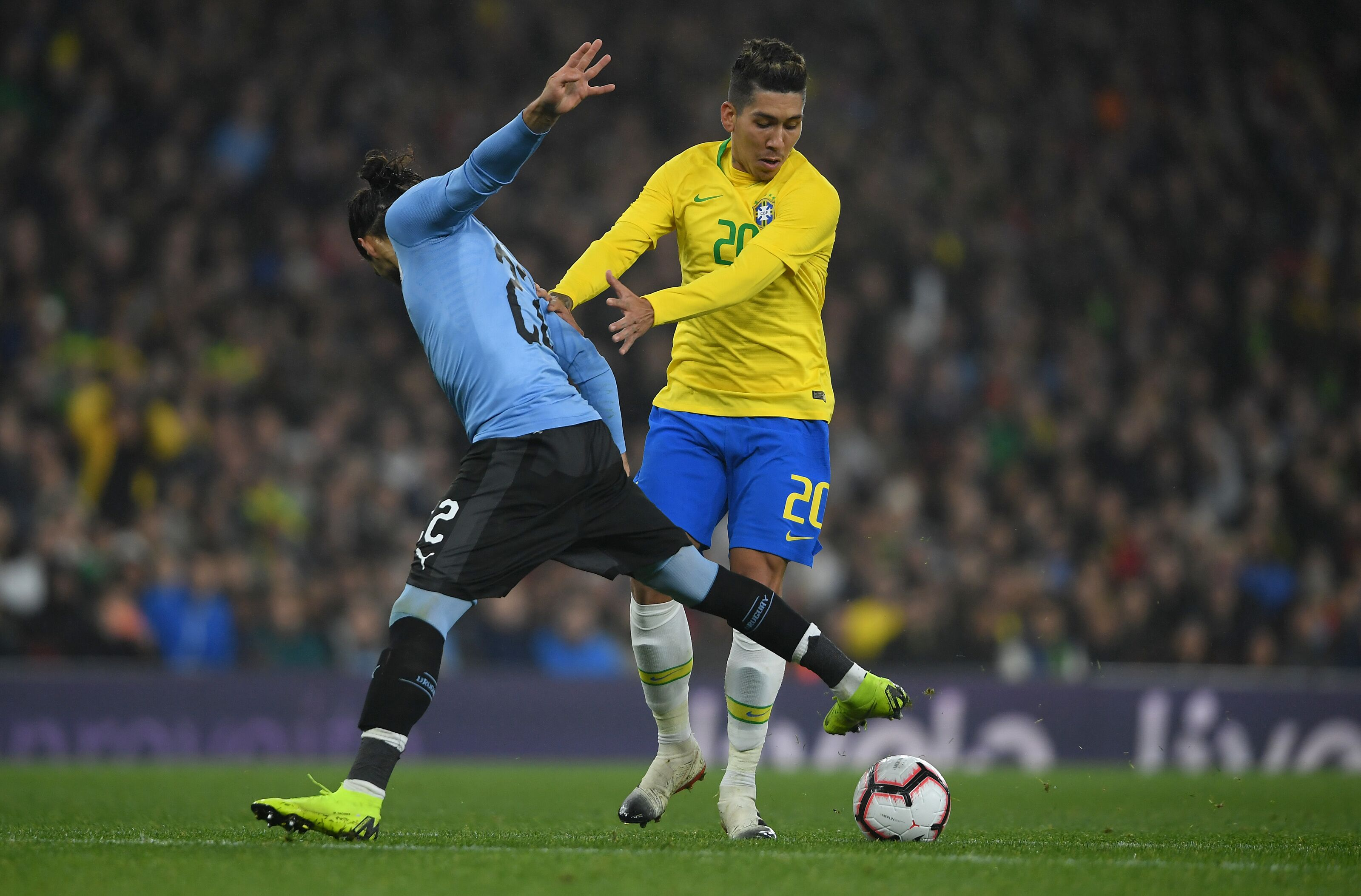 Feeling popular? Roberto Firmino crowded out against Argentina