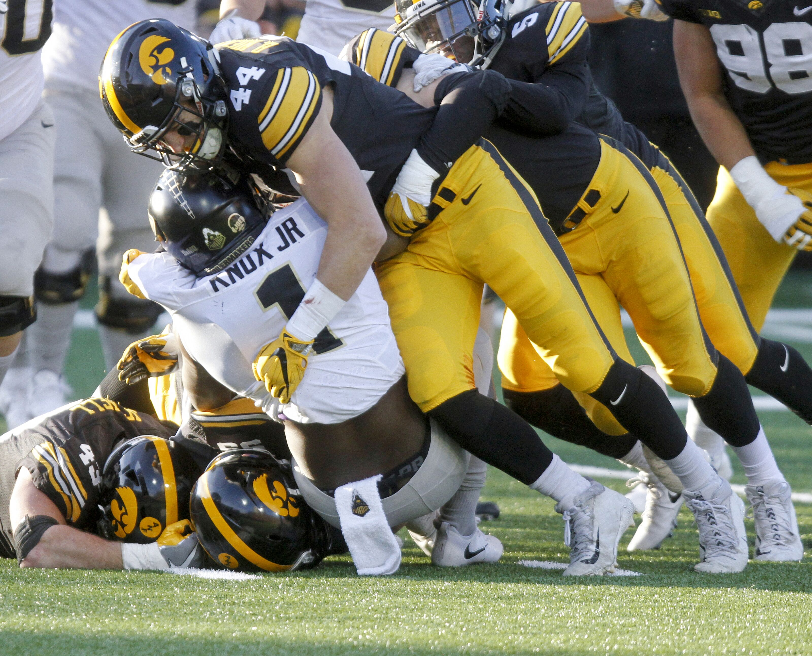 Iowa City November 18 Running Back D J Knox 1 Of The Purdue Boilermakers Is Brought Down In Second Quarter By Linebacker Ben Niemann 44