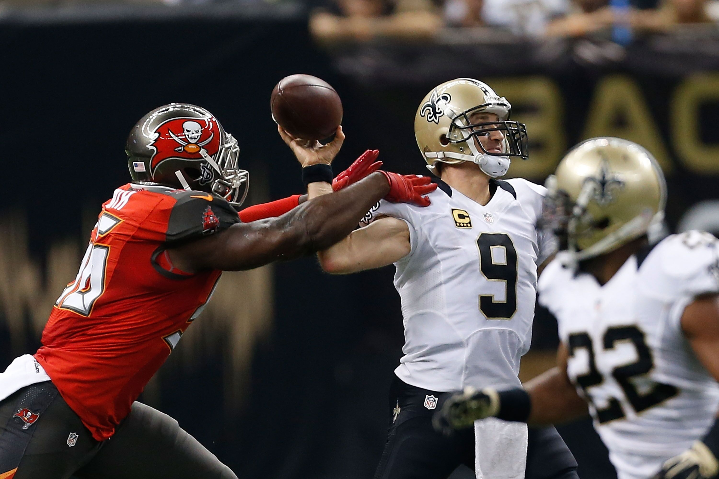 NEW ORLEANS, LA - SEPTEMBER 20: Drew Brees #9 of the New Orleans Saints is hit by Jacquies Smith #56 of the Tampa Bay Buccaneers during the first quarter of a game at the Mercedes-Benz Superdome on September 20, 2015 in New Orleans, Louisiana. </p>                 </div>             </div>          </div>                   <div class=