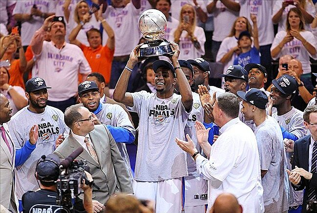 5f299389ca68 ... Oklahoma City Thunder small forward Kevin Durant (35) holds up the  Western Conference Championship trophy after defeating the San Antonio Spurs  in game ...