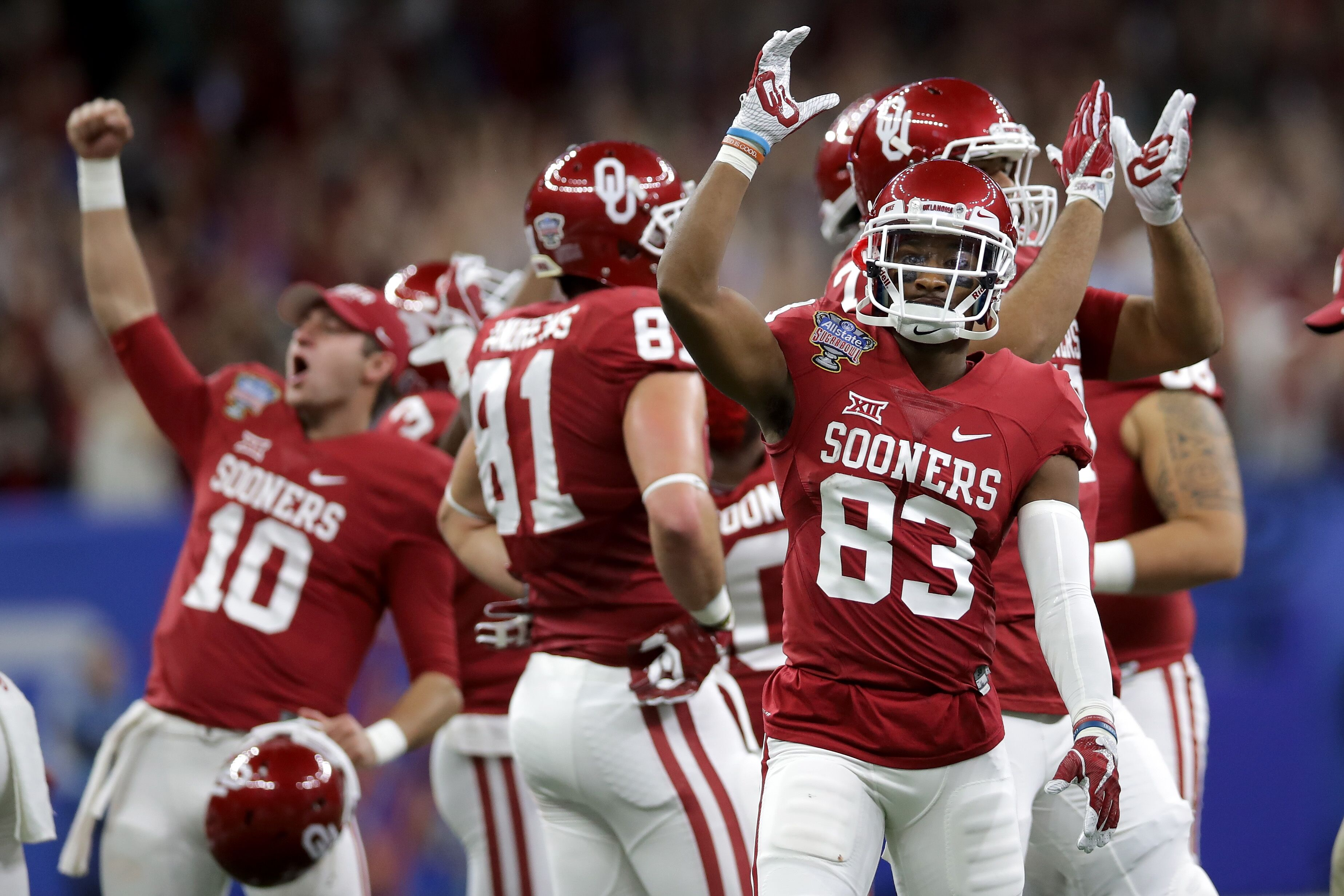 NEW ORLEANS LA – JANUARY 02 Members of the Oklahoma Sooners react after a touchdown against the Auburn Tigers during the Allstate Sugar Bowl at the
