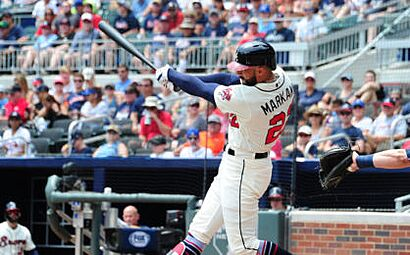 ATLANTA, GA - AUGUST 12: Nick Markakis #22 of the Atlanta Braves knocks in a run with a first inning triple against the Milwaukee Brewers at SunTrust Park on August 12, 2018 in Atlanta, Georgia. (Photo by Scott Cunningham/Getty Images)