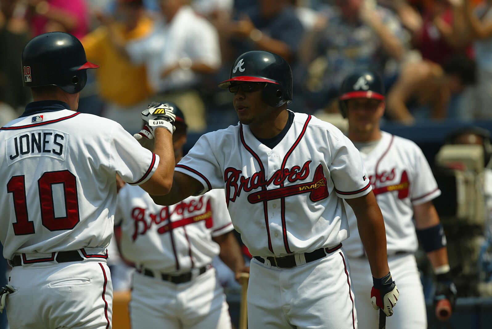 ATLANTA - SEPTEMBER 11: Left fielder Chipper Jones #10 of the Atlanta Braves receives congratulations from center fielder Andruw Jones #25 after one of his two home runs during the first game of a MLB double-header against the New York Mets on September 11, 2002 at Turner Field in Atlanta, Georgia. The Braves won 8-5. (Photo by Jamie Squire/Getty Images)