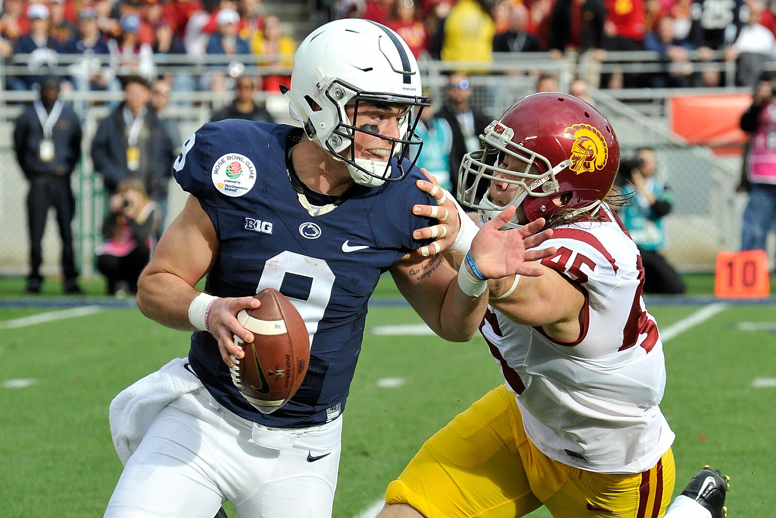 8f52e23d PASADENA, CA – JANUARY 02: Defensive end Porter Gustin #45 of the USC  Trojans attempts to tackle quarterback Trace McSorley #9 of the Penn State  Nittany ...