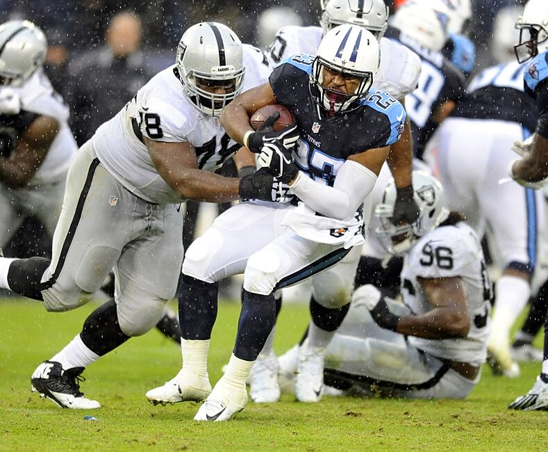 Nov 29 2017 Nashville Tn Usa Tennessee Ans Running Back David Cobb 23 Is Tackled By Oakland Raiders Defensive Tackle Justin Ellis 78 After A