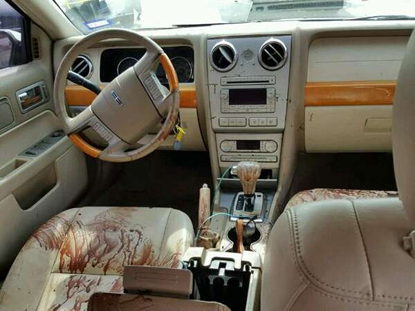 you won 39 t believe how much blood is inside this 2007 lincoln mkz at a copart salvage auction. Black Bedroom Furniture Sets. Home Design Ideas