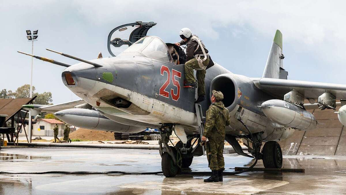 VADIM GRISHANKIN/RUSSIAN FEDERATION VIA AP A Russian pilot climbs into an Su-25 Frogfoot ground attack aircraft at the Kremlin's Khmeimim air base in Syria.