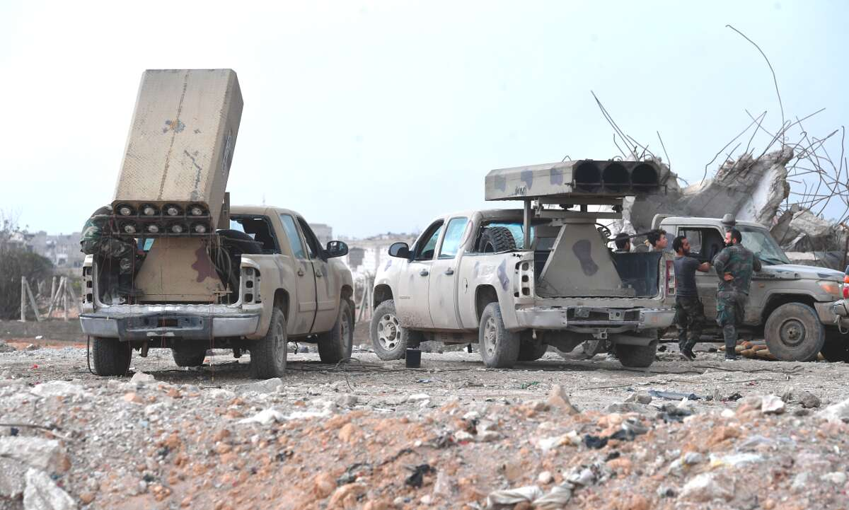 Pro-Assad forces with truck-mounted improvised rocket launchers