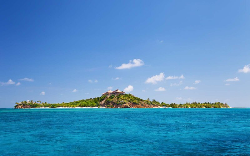 view of luxurious Necker Island, British Virgin Islands taken from a boat Richard Branson Holiday Retreat Rental