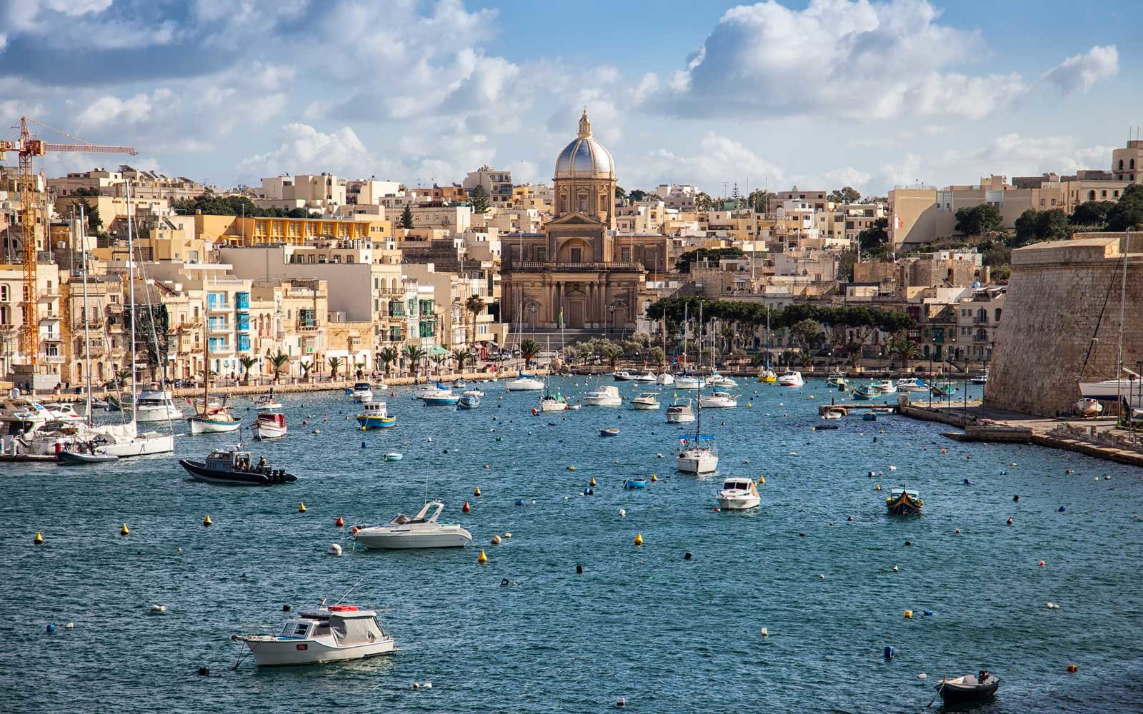 Sailing boats on Senglea marina in Grand Bay, Valetta, Malta