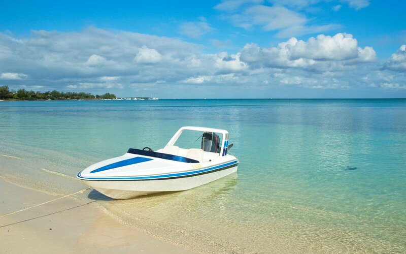 Tour Boat At The Beach Of Mont Choisy.