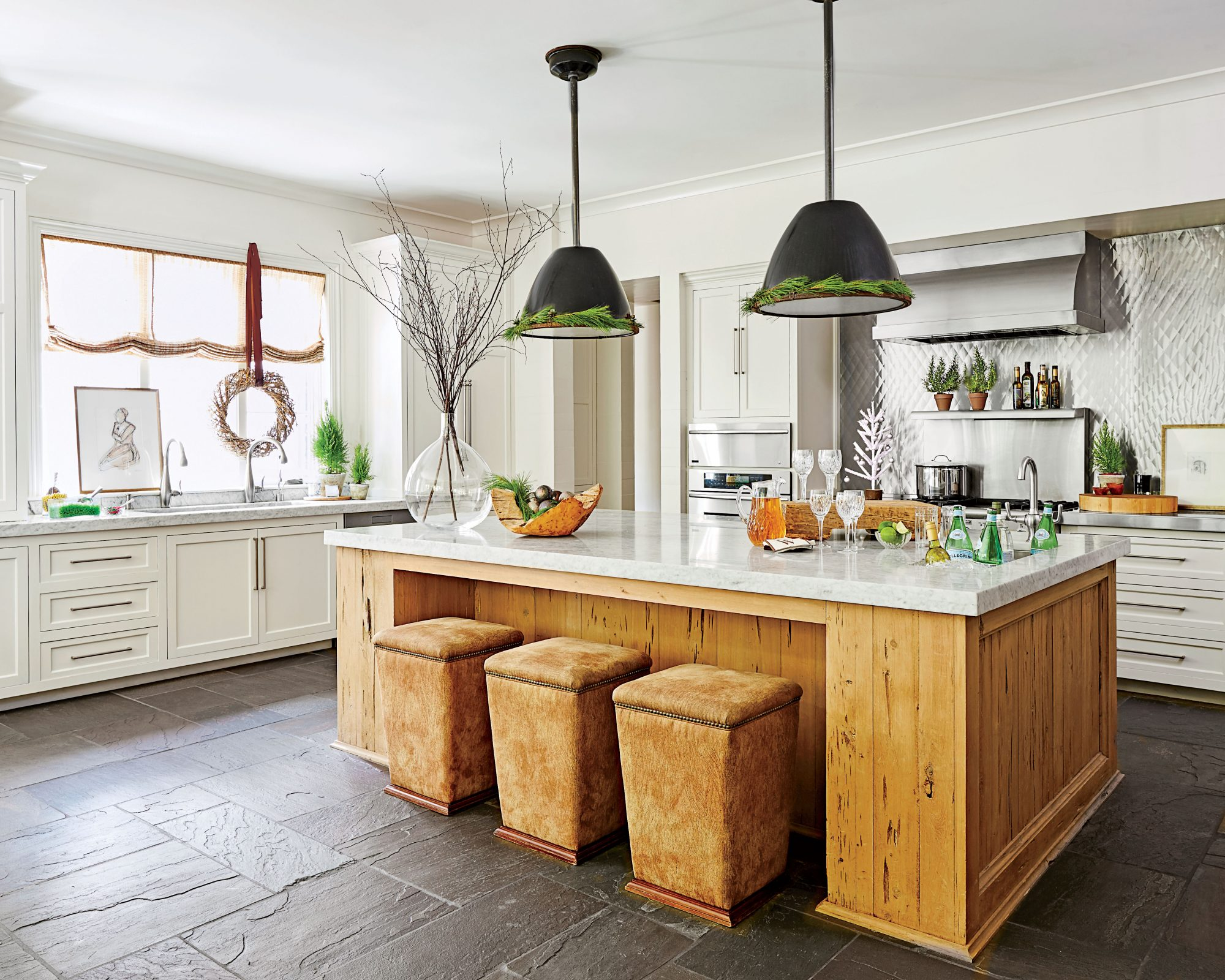 Christmas decorations and rustic wood island in Dana Wolter white kitchen