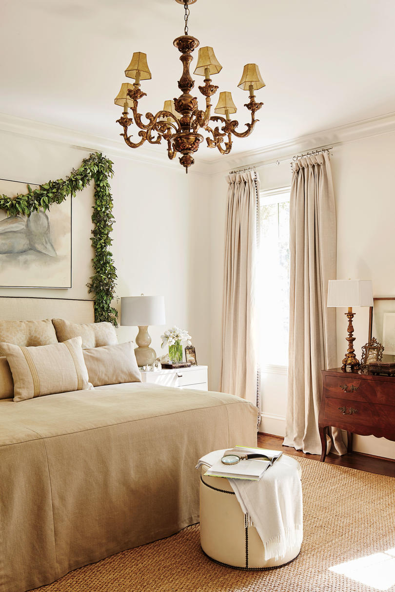 Neutral Bedroom with Linen Headboard and fresh green garland decorated for Christmas - Dana Wolter