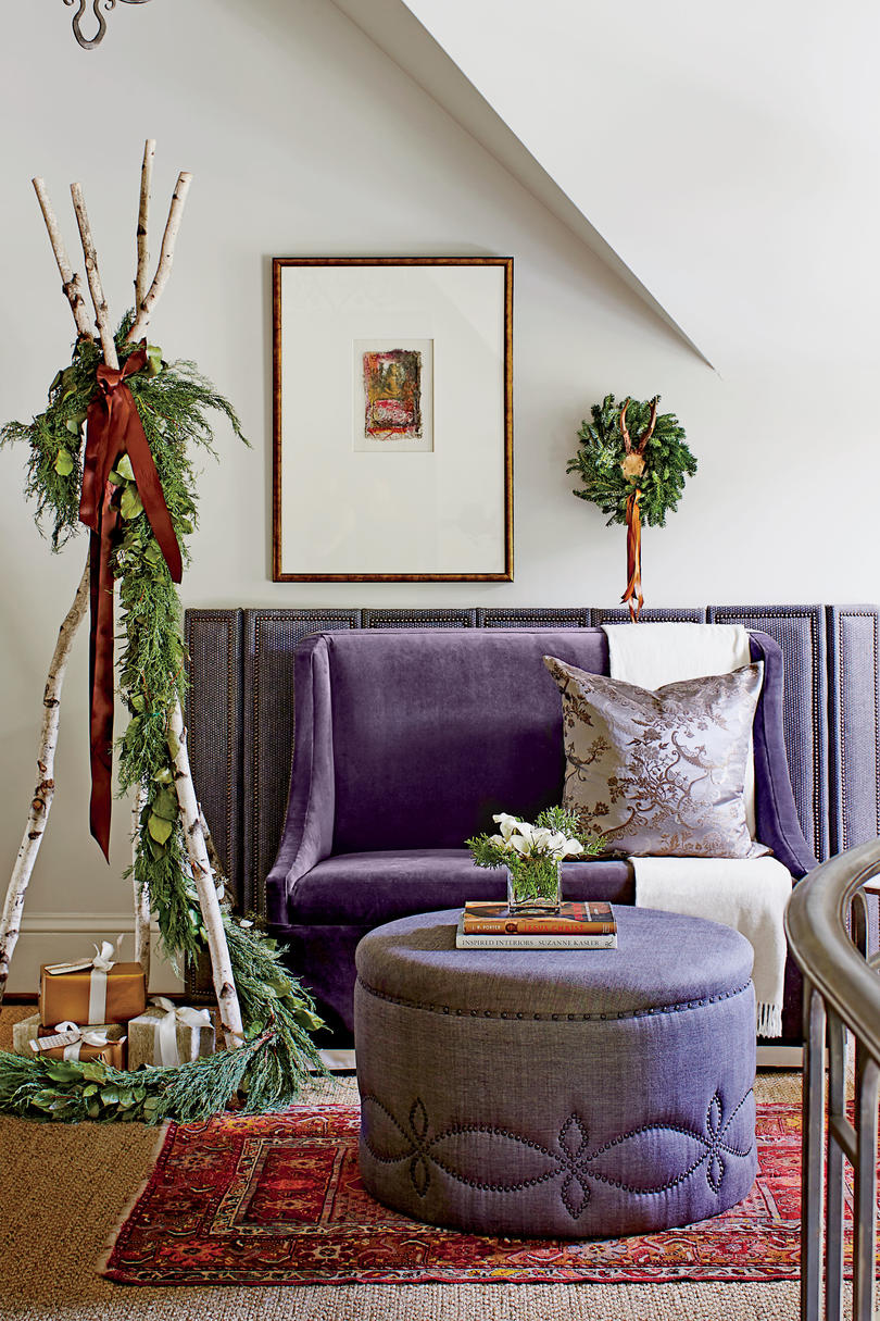Christmas decorations and purple velvet in Dana Wolter Stair Landing Seating Area