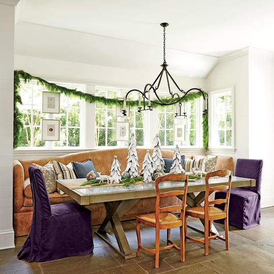 Christmas garland and Christmas trees on dining table with Kitchen Banquette - Dana Wolter