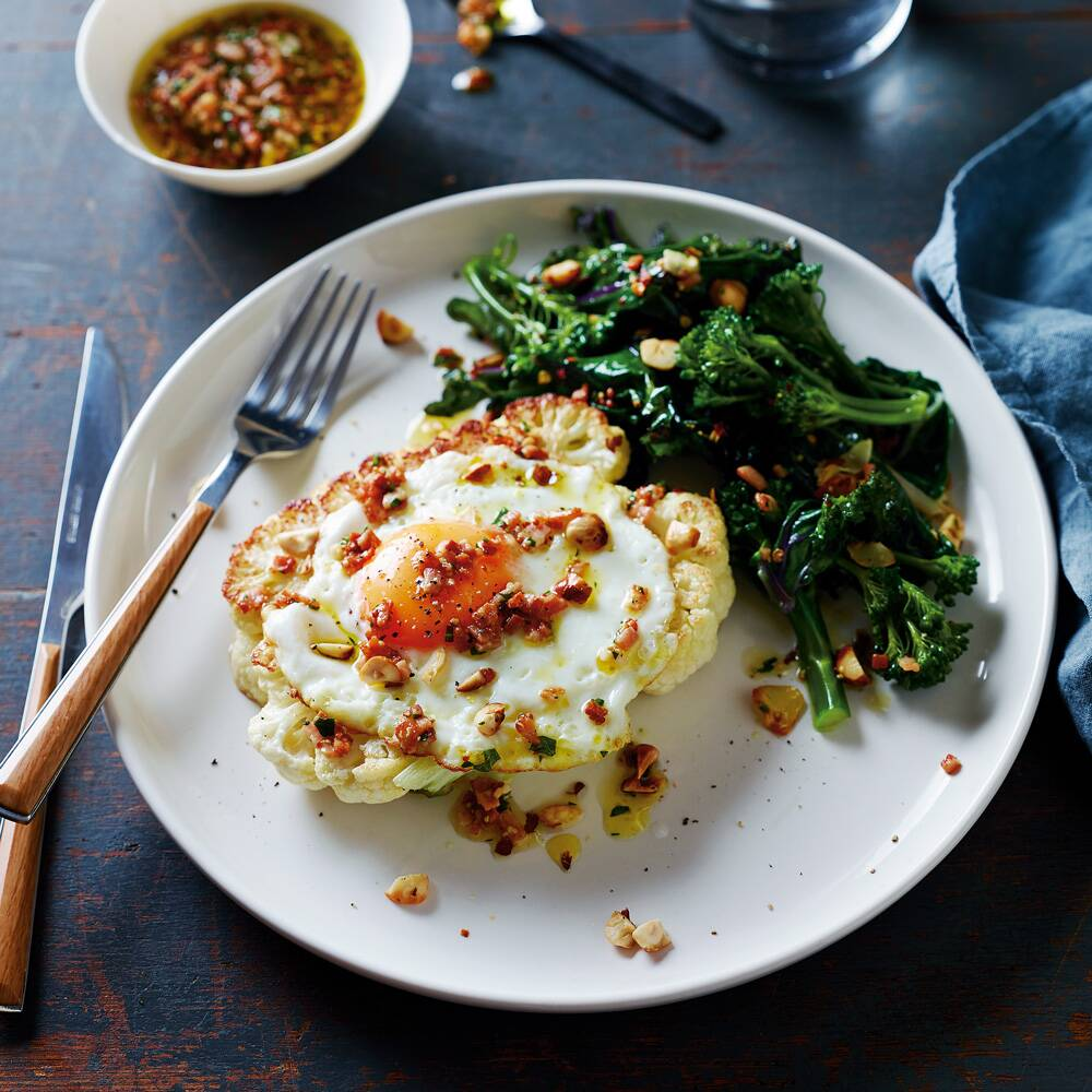 Cauliflower steak and eggs with sauteed greens recipe pete evans cauliflower steak and eggs the complete gut health cookbook by pete evans forumfinder Images