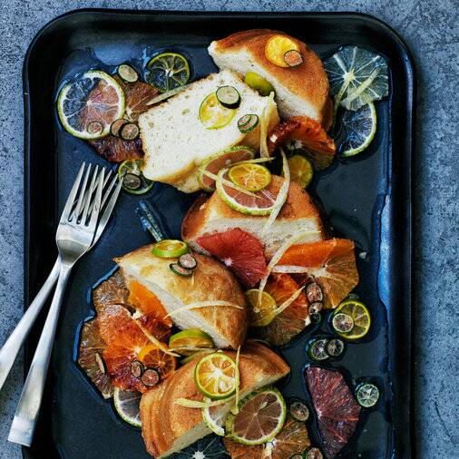 babas au rhum with mixed citrus fruits - Traditional Italian Christmas Dinner