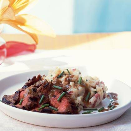 Bourbon And Brown Sugar Flank Steak With Garlic Chive Mashed Potatoes